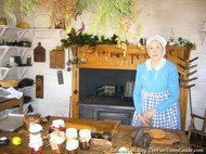 Root_House_Museum_attendant_in_authentic_kitchen.JPG