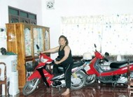 Sipaphay_on_a_scooter_in_dining_room.jpg