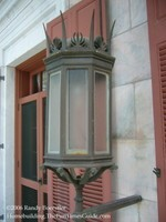 Tate_House_front_porch_medieval-like_sconce.JPG