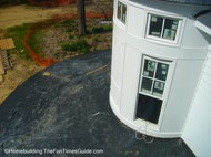 look how beautiful this victorian style house looks with the turret being prepped for the metal roof.