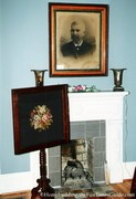 antique_cross-stitch_and_portrait_over_fireplace.jpg