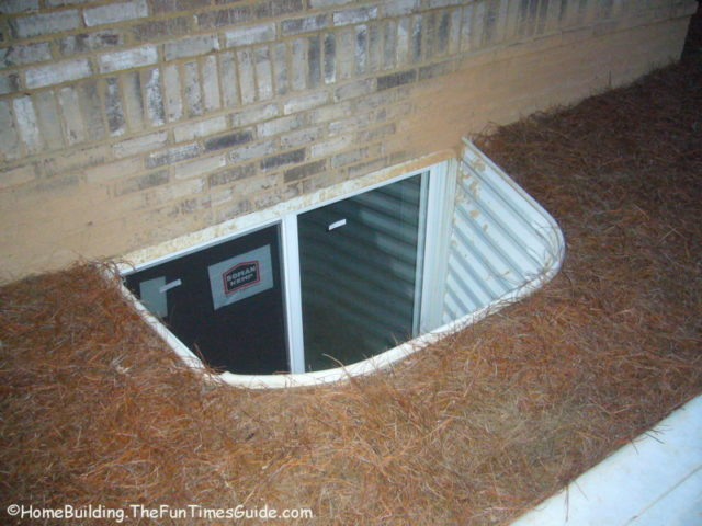 Basement egress window wells what you need to know the for Finishing a basement step by step guide