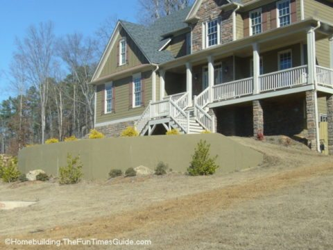 here is a nicely landscaped concrete retaining wall that is complete