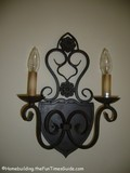 dual_candle_sconce_with_scroll.JPG