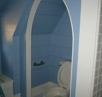 A Uniquely Styled Gothic Arch Entry Water Closet