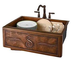 a copper farmhouse kitchen sink