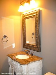 framed_mirror_and_white_furniture_vanity.JPG