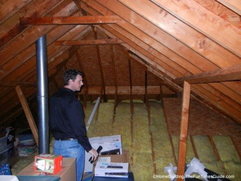 Doing a home energy audit in the attic
