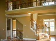 open staircase designs can include lots of iron balusters like this one