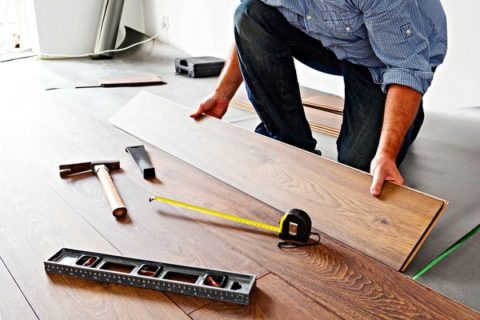 How do you install hardwood laminate flooring?