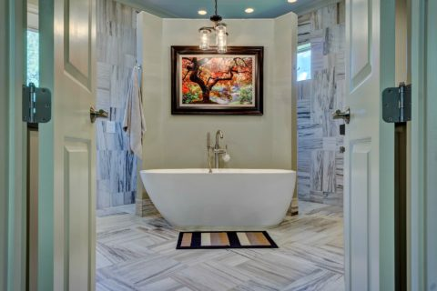 Do you really need a bathtub in your master bathroom? Here's a nice bathroom design that accommodates both - a large walk-in shower with 2 entrances, and a standalone tub.
