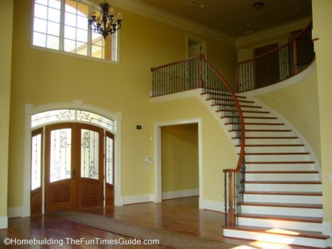 Open staircase designs allow for a really beautiful entryway in a large home like this
