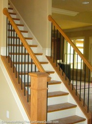 Here's the use of iron balusters as a part of open staircase designs