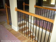this is a beautiful effect created by the open staircase designs the builder used
