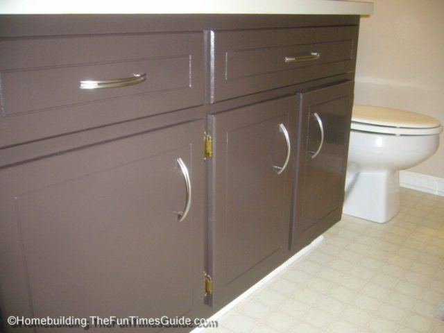 how to refinish your bathroom vanity cabinets for a fresh new look