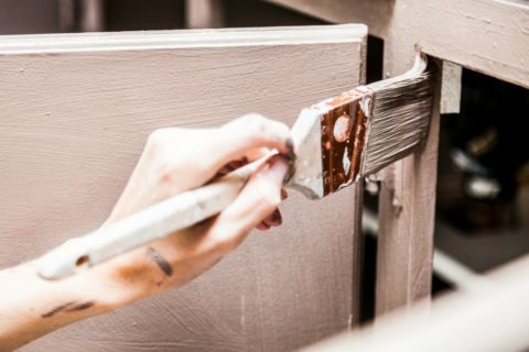 when refinishing bathroom cabinets paint the interior and exterior for a professional look