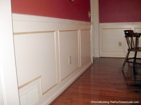 Picture frame moulding is a great way to finish off your dining room for cheap