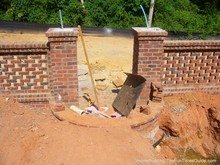 here's the brick fence about mid-way through the project