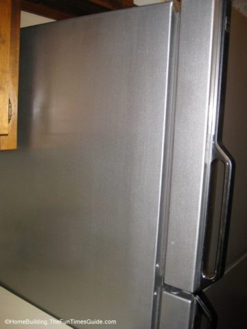 finished product - old refrigerator with a new coat of Thomas liquid stainless steel paint