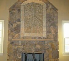 "This Stone Sunburst Fireplace ""Shines"""