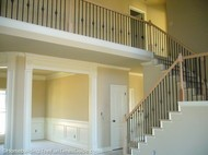 open staircase designs can include catwalks and balusters