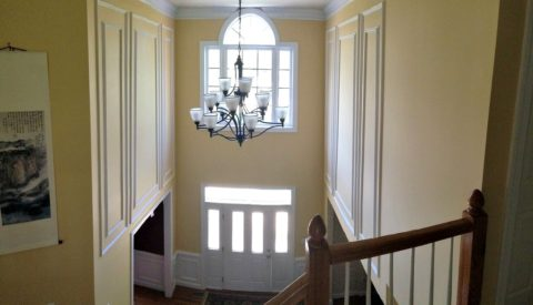 A spacious, modern 2-story foyer.