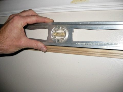 Using a level to install picture frame moulding