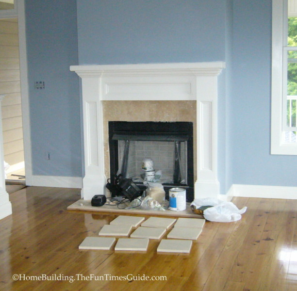 A fireplace with travertine tile the homebuilding for Homebuilding com