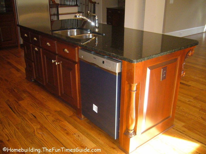 ... center island with double sink, Bosch dishwasher and custom cabinetry