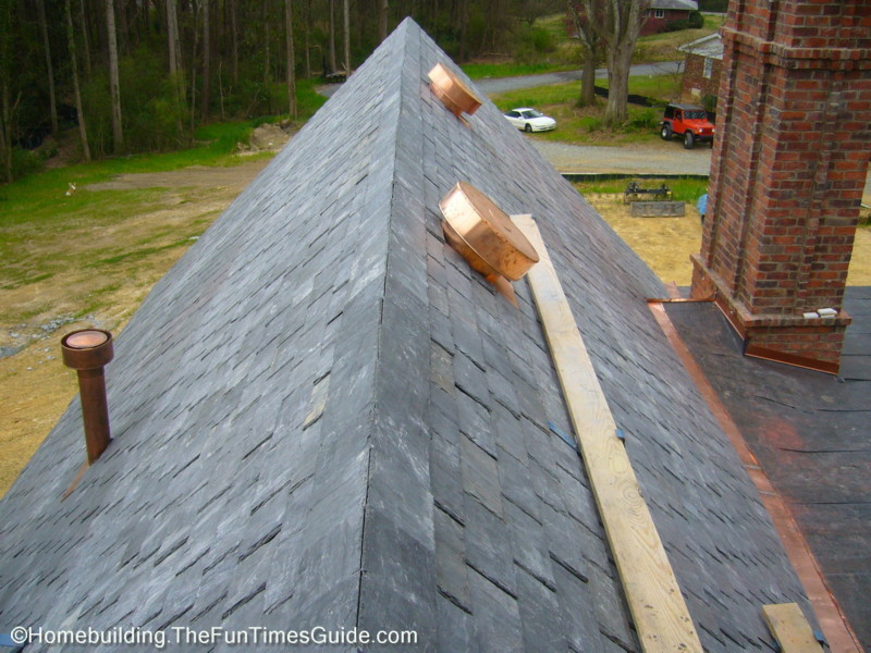 Completed_slate_roof_over_master_suite.JPG  Chimneys_stand_guard_amongst_roofing_activities.
