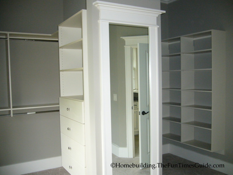 A custom his her walk in closet with dressing area fun for His and hers closet