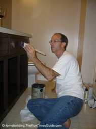 when refinishing bathroom cabinets I find it important to apply more than one coat of paint
