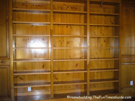 stained_and_lacquered_built-in-bookshelves_in_library.JPG